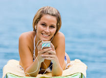 Woman listening to mp3 player Stock Photo