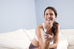 Woman listening to mp3 player with earbuds Stock Image