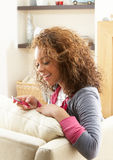 Woman Listening To MP3 Player On Headphones Royalty Free Stock Photos