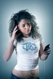 Woman listening to music. Portrait of beautiful and woman listening to music stock images