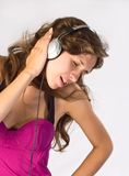 Woman Listening to Music. Woman Listening to  her favourite Music Royalty Free Stock Images