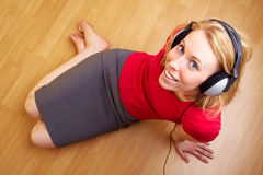 Woman listening to music. Happy woman with headphones listening to music royalty free stock photos