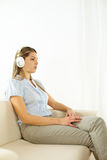 Woman listening to music Royalty Free Stock Photography