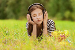 Woman listening to music through Royalty Free Stock Photo
