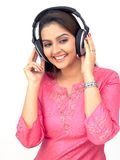 Woman listening to music. Happy woman with a headphone, listening to music Stock Photography