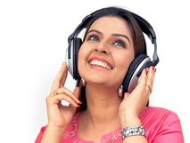 Woman listening to music. Happy woman with a headphone, listening to music Royalty Free Stock Photography