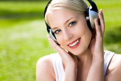 Woman listening to music Stock Photos