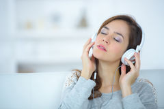 Woman listening to music. Woman listening to the music Royalty Free Stock Photography