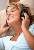 Woman listening to music Royalty Free Stock Image