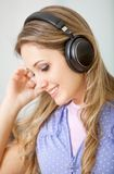 Woman listening to music Stock Photography