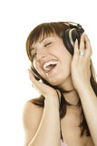 Woman Listening To Music And Singing Stock Images