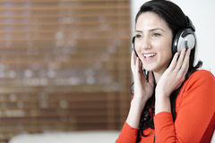 Woman listening to music Stock Image