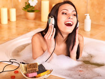 Woman listening to music in bath Stock Photo