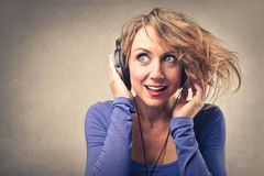 Woman listening to the music Royalty Free Stock Photography