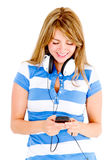 Woman listening to music on cell phone Stock Photos