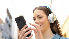 Woman listening to music checking songs stock footage
