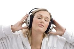Woman listening to music with closed eyes Stock Images