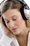 Woman listening to music with closed eyes Royalty Free Stock Photo