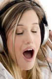 Woman listening to music with closed eyes Stock Photos
