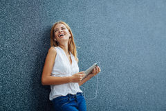 Woman listening to music on the digital tablet Royalty Free Stock Photos