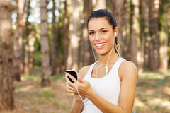 Woman listening to music through earbuds Royalty Free Stock Images