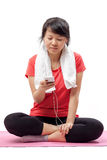 Woman listening to music in exercise outfit Stock Photography