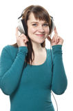 Woman listening to music on headphone Stock Images