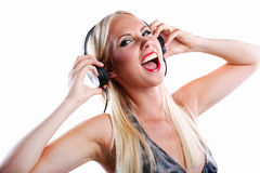 Woman listening to music on headphone Stock Photography