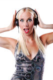 Woman listening to music on headphone Royalty Free Stock Photography