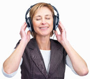 Woman listening to music on headphones Royalty Free Stock Image