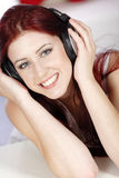 Woman listening to music on headphones Stock Photography