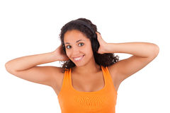 Woman listening to music with headphones Stock Photos