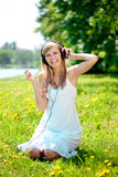 Woman listening to music on headphones o Stock Photos