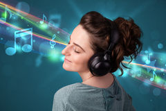 Woman listening to music with headphones Royalty Free Stock Photos
