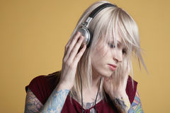 Woman Listening To Music With Headphones Stock Photography