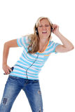 Woman listening to music from her cellphone headphones Royalty Free Stock Photo