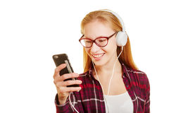 Woman listening to music with her headphones Royalty Free Stock Photos