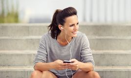 Woman Listening to Music on her Phone Stock Images