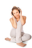 Woman listening to music isolated Royalty Free Stock Photo
