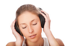 Woman listening to music isolated Stock Photos