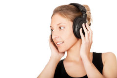 Woman listening to music isolated Stock Image