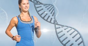 Woman listening to music while jogging by DNA structure royalty free stock photos