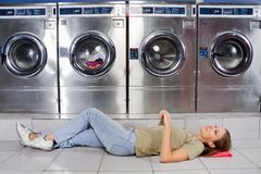 Woman Listening To Music While Lying At Laundry Royalty Free Stock Photo