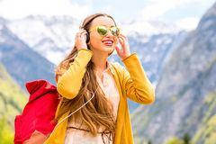 Woman listening to the music in the mountains Royalty Free Stock Image