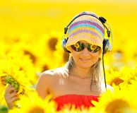 Woman listening to music outdoor Stock Photography