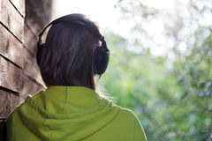 Woman listening to music outdoor Royalty Free Stock Image