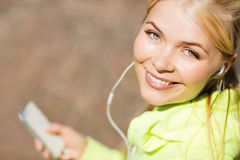 Woman listening to music outdoors Stock Photos