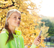 Woman listening to music outdoors Stock Photography