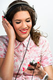 Woman listening to music over a phone Stock Photos