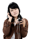 Woman listening to music with the phone and having fun Stock Images